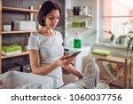 woman wearing white shirt using ... | Shutterstock . vector #1060037756