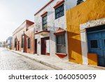 colorful empty colonial street... | Shutterstock . vector #1060050059