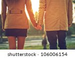 happy couple holding hands... | Shutterstock . vector #106006154