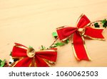 christmas red bow ribbon over... | Shutterstock . vector #1060062503