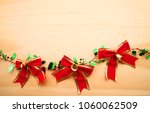 christmas red bow ribbon over... | Shutterstock . vector #1060062509