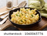 baked macaroni and cheese in a... | Shutterstock . vector #1060065776