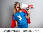 pretty superhero girl shouting... | Shutterstock . vector #1060070714