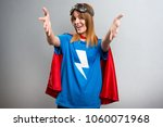pretty superhero girl... | Shutterstock . vector #1060071968