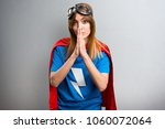 pretty superhero girl pleading... | Shutterstock . vector #1060072064