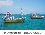 several traditional local boats ... | Shutterstock . vector #1060072310