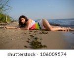 beautiful girl lying on the... | Shutterstock . vector #106009574