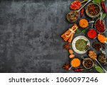 various spices spoons on stone... | Shutterstock . vector #1060097246