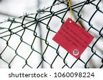 Aldermaston, United Kingdom, 1st April 2018:- Messages left on the fence outside the main gate to the AWE, on the 60th anniversary of the first CND march in 1958 - stock photo