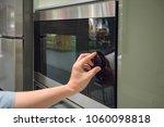 woman's hands adjusting timing... | Shutterstock . vector #1060098818