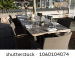 fancy table setting at outdoor... | Shutterstock . vector #1060104074