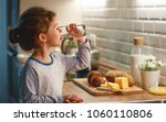 child girl is drinking water in ... | Shutterstock . vector #1060110806