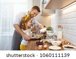 happy family in kitchen. father ... | Shutterstock . vector #1060111139