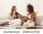excited woman getting gift from ... | Shutterstock . vector #1060114733