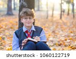Cute Young Boy In Round Glasse...