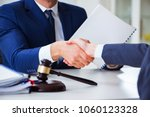 lawyer talking to his client in ...   Shutterstock . vector #1060123328