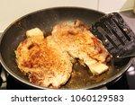 pork chops in a pan | Shutterstock . vector #1060129583