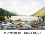 beautiful mountain lake with... | Shutterstock . vector #1060158734