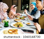 islamic friends dining together | Shutterstock . vector #1060168730