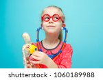 little funny blonde girl with... | Shutterstock . vector #1060189988