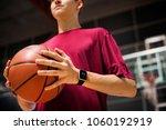 teenage boy holding a... | Shutterstock . vector #1060192919