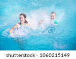 two cute kids laughing and... | Shutterstock . vector #1060215149