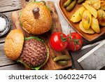 tasty grilled home made burgers ... | Shutterstock . vector #1060224704