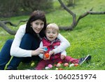 easter   eggs  mama and boy | Shutterstock . vector #1060251974