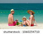 family on beach. two year old... | Shutterstock . vector #1060254710