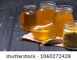 honey with wooden honey dipper... | Shutterstock . vector #1060272428