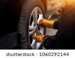auto mechanic man with electric ... | Shutterstock . vector #1060292144