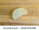 Small photo of Hunch white bread on wooden board. Photo.