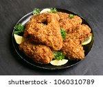 appetizing crispy chicken wings.... | Shutterstock . vector #1060310789
