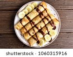 delicious crepes roll with... | Shutterstock . vector #1060315916