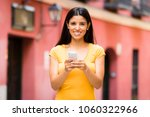 happy young latin woman talking ... | Shutterstock . vector #1060322966