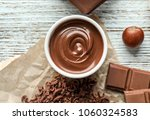 bowl with tasty melted... | Shutterstock . vector #1060324583