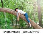 pretty woman sleeping in a tree ... | Shutterstock . vector #1060324949