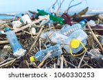 spilled garbage on the beach of ... | Shutterstock . vector #1060330253