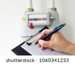person reading the gas meter in ... | Shutterstock . vector #1060341233