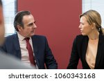 Small photo of Businessman And Businesswoman In Mediation Meeting