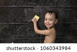 small boy washes the tile in... | Shutterstock . vector #1060343984