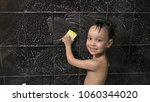 small boy washes the tile in... | Shutterstock . vector #1060344020