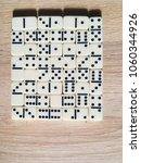 dominoes pieces on a wooden... | Shutterstock . vector #1060344926