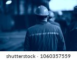 workers  helmets at the factory ... | Shutterstock . vector #1060357559