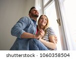 happy and in love couple  | Shutterstock . vector #1060358504