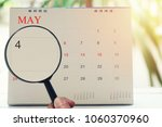 magnifying glass in hand on... | Shutterstock . vector #1060370960