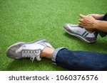 a man is sitting to tie shoes | Shutterstock . vector #1060376576