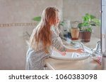 little girl washes her hands in ... | Shutterstock . vector #1060383098
