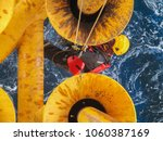 male worker rope access ... | Shutterstock . vector #1060387169