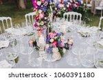 flower arrangement stands on... | Shutterstock . vector #1060391180